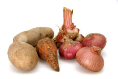 Roots, bulbs & tubers. Potatoes, sweet potato and red onions Stock Photos
