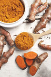 Roots and powder turmeric Stock Images