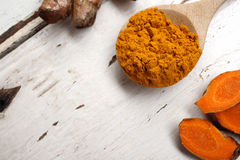 Roots and powder turmeric Royalty Free Stock Photo