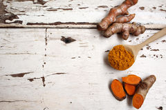 Roots and powder turmeric. The roots and powder turmeric Royalty Free Stock Image
