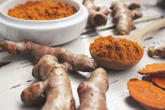Roots and powder turmeric Stock Photography