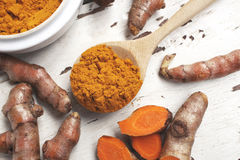 Roots and powder turmeric Stock Photo