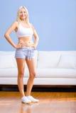 Ropa del ejercicio de la mujer que desgasta joven Imagen de archivo
