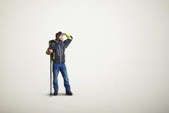 Ropa del invierno del desgaste de hombre y mirada lejos Foto de archivo
