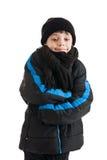 Ropa del invierno del muchacho que lleva Fotos de archivo