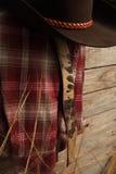 Ropa del vaquero en la cerca de madera Fotografía de archivo libre de regalías
