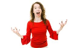 Ropa flickan i röd klänningvisninggest av aggressivt uppförande royaltyfria foton