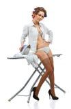 Ropa que plancha de la mujer atractiva Imagen de archivo libre de regalías