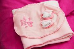 Ropa rosada del bebé Foto de archivo