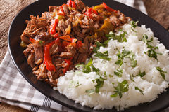 Ropa vieja: beef stew in tomato sauce with vegetables and rice g Royalty Free Stock Image