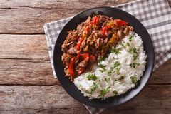 Ropa vieja: beef stew in tomato sauce with vegetables and rice. royalty free stock photo
