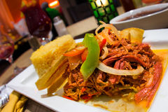 Ropa Vieja Spanish Shredded Beef. Traditional Spanish meal of shredded beef Ropa Vieja with rice Royalty Free Stock Photography