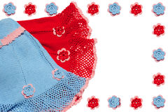 Ropa y flores hechas punto del bebé Imágenes de archivo libres de regalías