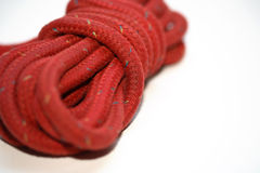 Rope. A red rope and a white background Stock Image
