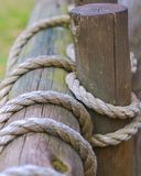 Rope. Coils of rope tied against a wooden pole Royalty Free Stock Image