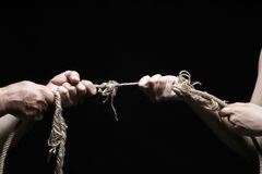 Rope. Photo of a rope with hand pulling Royalty Free Stock Photo