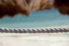 Rope and beach umbrella Stock Images