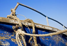 Rope on an abandoned wreck. Abandoned boat wreck with rotting rope hanging from it Stock Images