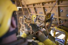 Rope access miner commencing rope transferring using descender maneuvering from left to right stock image