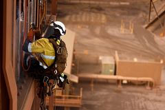 Free Rope Access Stick Welder Wearing Full Body Safety Harness Equipment, Abseiling Working At Height Conducting Welding Chute Parent R Royalty Free Stock Image - 165522976