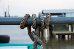 Rope across around steel tube Royalty Free Stock Images
