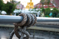 Rope across around steel tube Royalty Free Stock Image