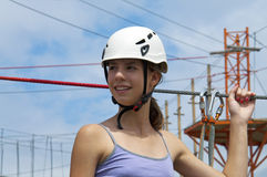 At rope adventure park a young woman looking back Stock Photo