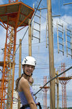 At rope adventure park a young woman looking back Royalty Free Stock Image