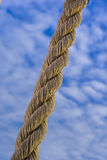 Rope against blue sky. A hanging rope against a blue sky Stock Photography