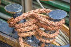 Rope with anchored ship Stock Images