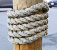Rope around wood Stock Photo