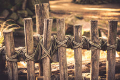 Rope around wooden fence Stock Photography