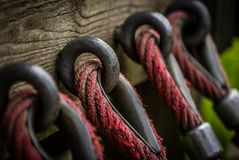 Rope attachement. Detail of a rope attached to a wooden wall Stock Photography