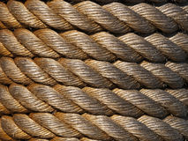 Rope Background. Thick worn rope wound around a pilon Royalty Free Stock Image