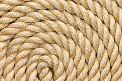 Rope background texture neatly wound into a coil Stock Photos