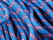 Rope backgrounds and textures. Close-up twisted texture of red-blue nylon rope Stock Image