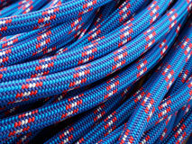 Rope backgrounds and textures. Close-up twisted texture of red-blue nylon rope Stock Images