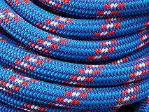 Rope backgrounds and textures. Close-up twisted texture of red-blue nylon rope Stock Photos