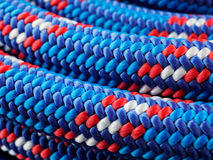 Rope backgrounds and textures. Close-up twisted texture of red-blue nylon rope Royalty Free Stock Photo