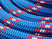 Rope backgrounds and textures. Close-up twisted texture of red-blue nylon rope Royalty Free Stock Images