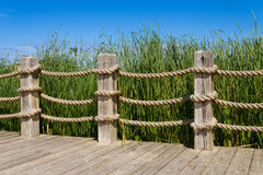Rope bannister. Rope and wooden post bannister railing royalty free stock photos