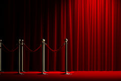 Rope barrier with red carpet and curtain. Velvet red rope barrier with a shining curtain on the right Stock Photos