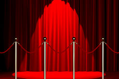 Rope barrier with red carpet and spotlight Stock Photo