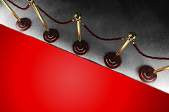 Rope barrier with red carpet. A velvet rope barrier with big red carpet in top view Royalty Free Stock Image