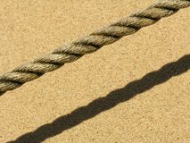 Rope on the beach. A rope on a sandy beach Stock Image