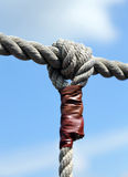 Rope with big node and the blue sky Stock Image