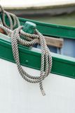 Rope on boat. In water Stock Image