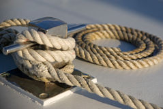 Rope on a boat deck. Rope neatly rolled up on the deck of a  boat Stock Images