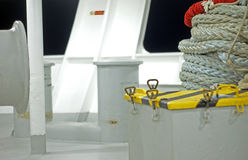 Rope on boat deck. Rope and pieces of equipment on the deck of a ship or boat royalty free stock photography