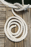 Rope of boat tied to a jetty cleat Stock Image